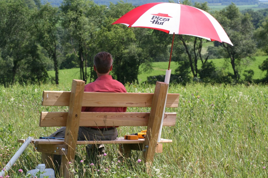 Jim built this fabulous bench and added an umbrella so we could watch our prairie grow!