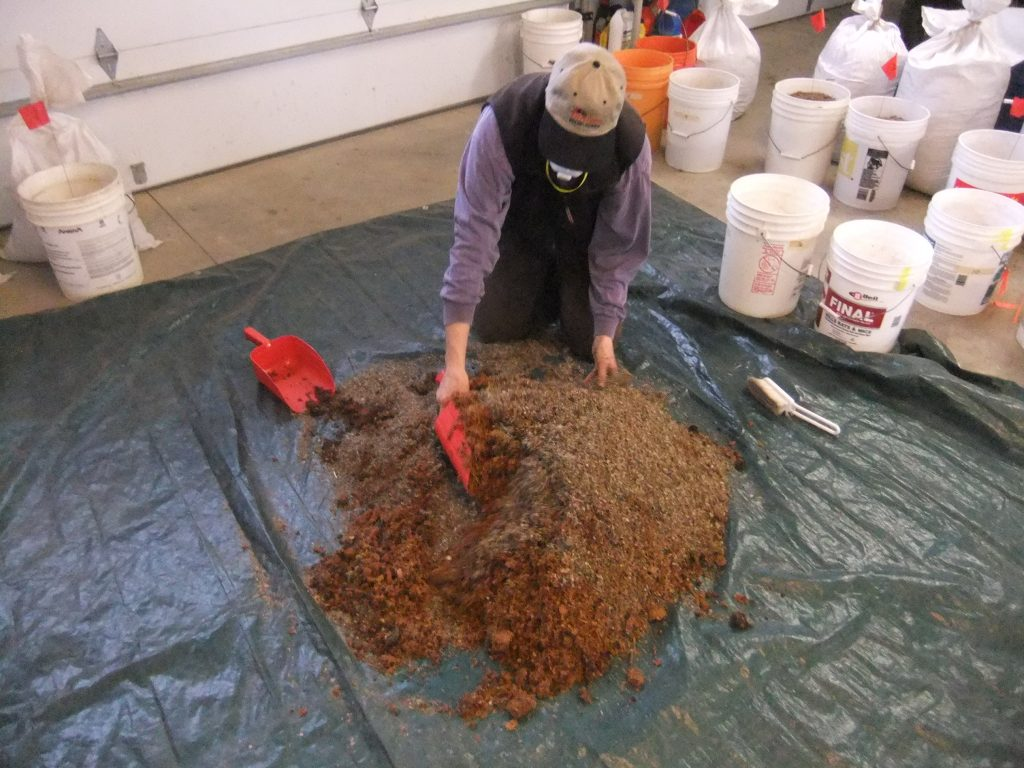 One section's seed mix is getting sawdust added and mixed into it.