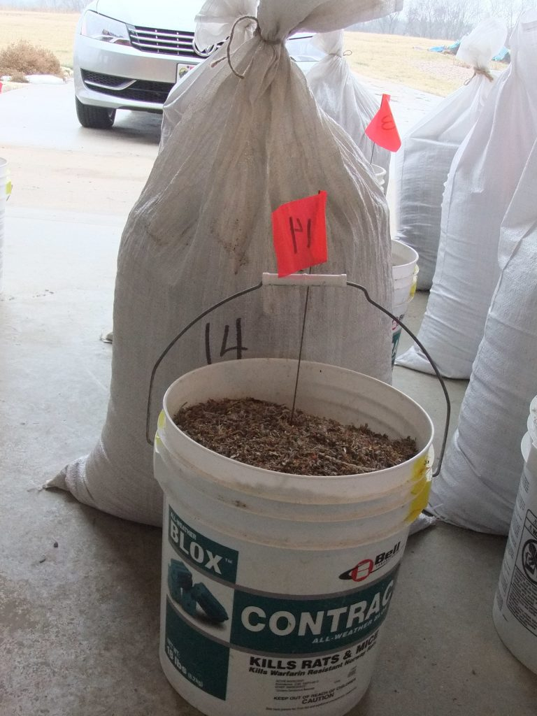 Each bucket has a flag with a number corresponding to their section and a bag of additional seed.