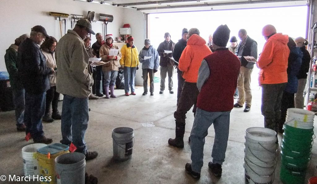 The brief volunteer orientation explaining the section layouts, buckets, and seed bags.