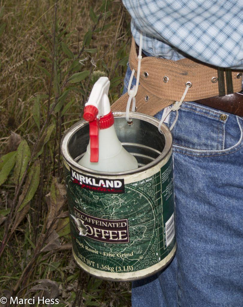 A coffee can is an excellent way to carry a spray bottle
