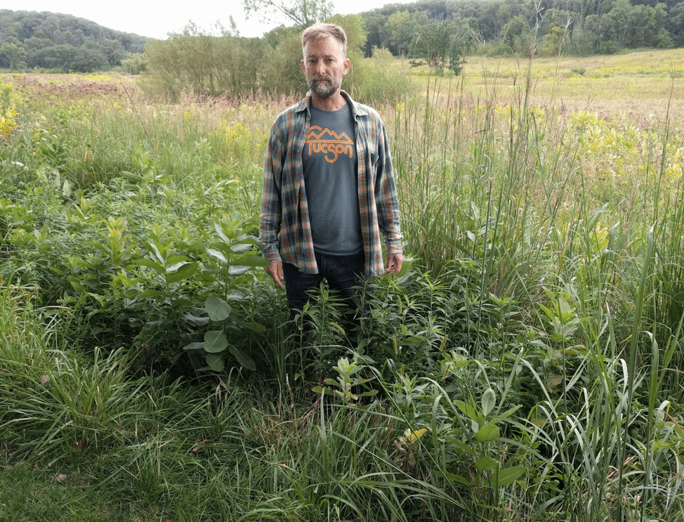 Andy in an area of Canada goldenrod that received the mowing treatment.